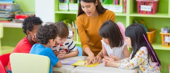 Teacher doing school activities with young children