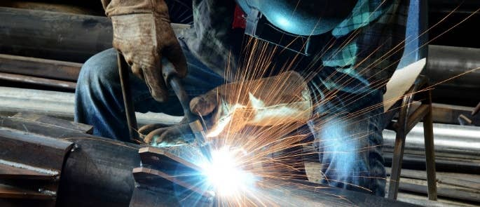 Worker carrying out welding hot work