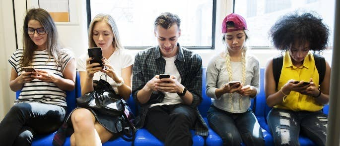 Group of sixth form students on their phones