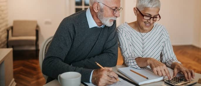 Carer assisting with an elderly man's bills