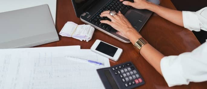 Woman carrying out bookkeeping tasks