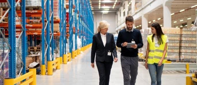 Workers walking in a warehouse talking