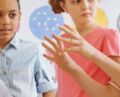 teacher managing a child's challenging behaviour in the classroom
