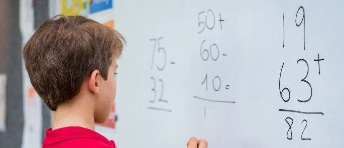 Working out sums on the board in a maths lesson