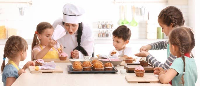 School Children Baking with their Teacher