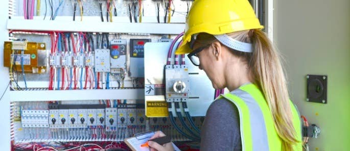 Electrician checking fuses