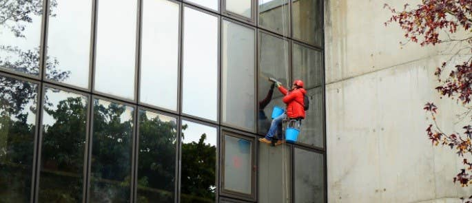 Lone worker cleaning windows