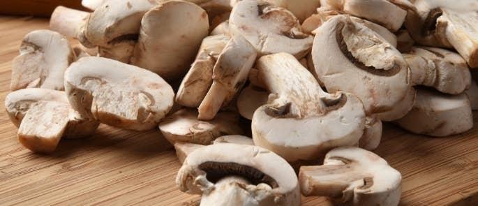 Raw mushrooms on a cutting board