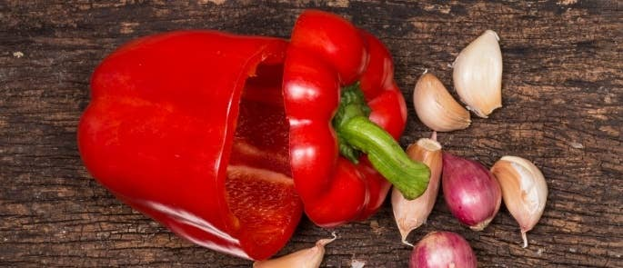 Raw red pepper and garlic cloves