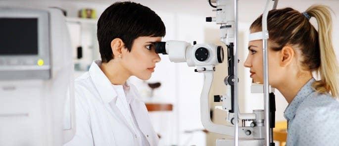 Woman receiving an eye test for an occupational health assessment