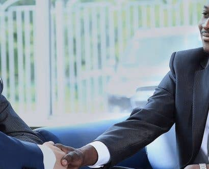 diverse business men shaking hands and controlling unconscious bias