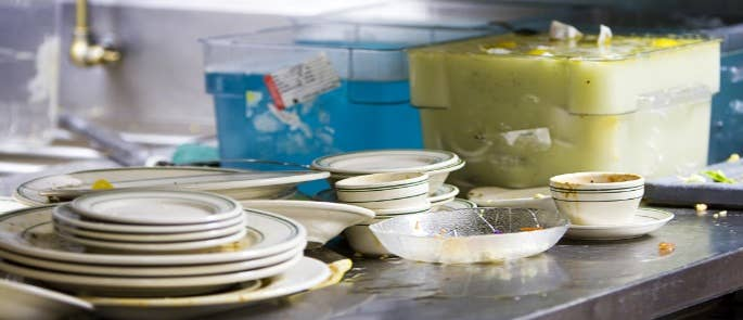 Dirty plates and cutlery in a restaurant kitchen