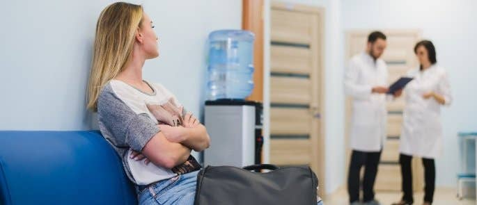 Woman waiting in a hospital waiting room