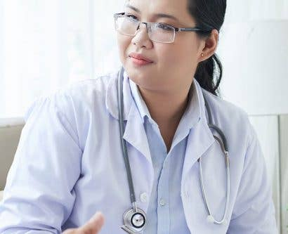 doctor discussing treatment with patient in confidence