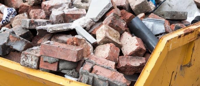 Skip full of construction waste bricks