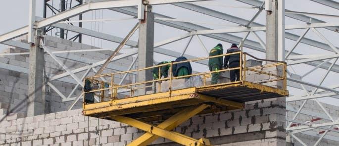 Workers on mobile elevated work platform
