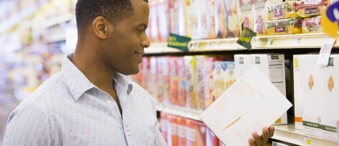 Man checking a food nutritional label in the supermarket