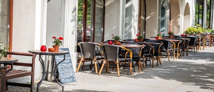 Tables and chairs outside a cafe