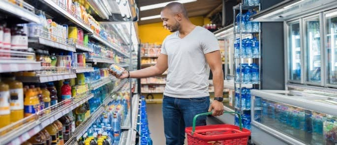 Man in supermarket with shopping basket