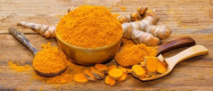 The spice turmeric in root and powder form