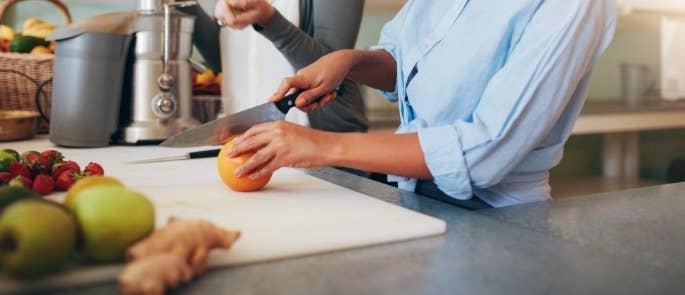 Women preparing fruit juice in their home kitchen