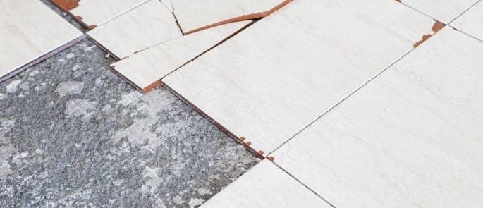 Broken floor tiles that contain asbestos