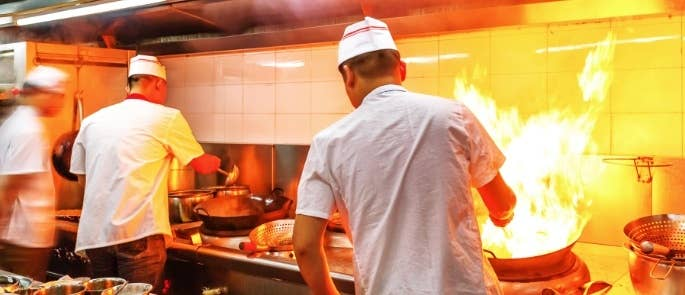 Chefs cooking in a commercial kitchen
