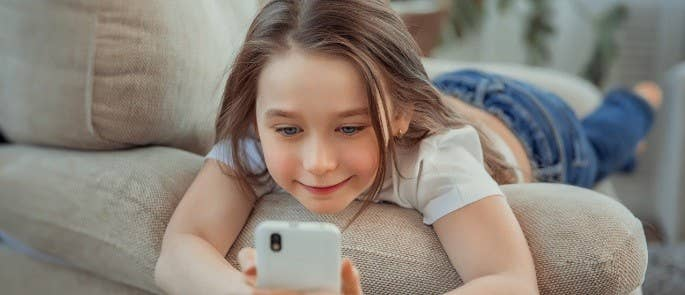 Young girl on the internet on her phone