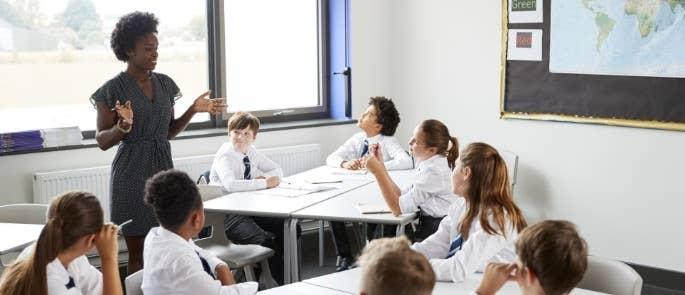 A teacher talking to children in a classroom