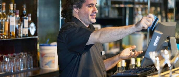 Bartender using a credit card