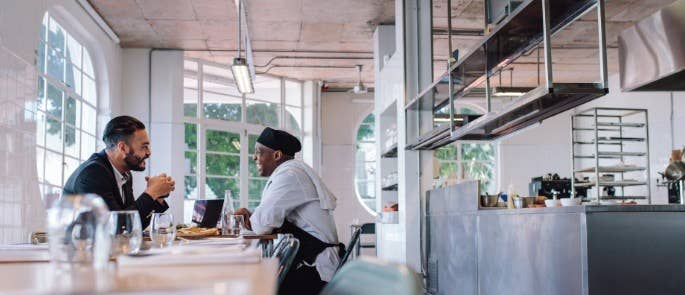 Chef chats with young man who has come to interview for a kitchen position