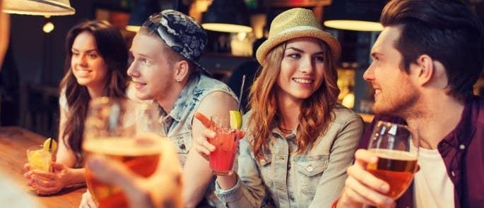 Customers at a bar drinking