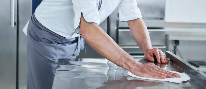 Man cleaning kitchen surfaces