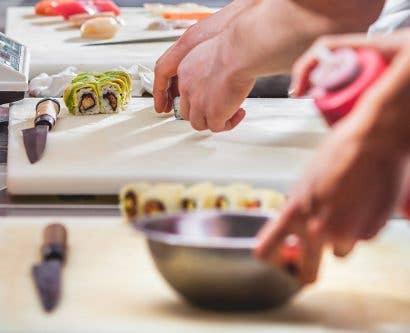 sushi chefs prepare food in virtual restaurant