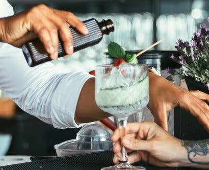 bar staff making cocktail in trial interview