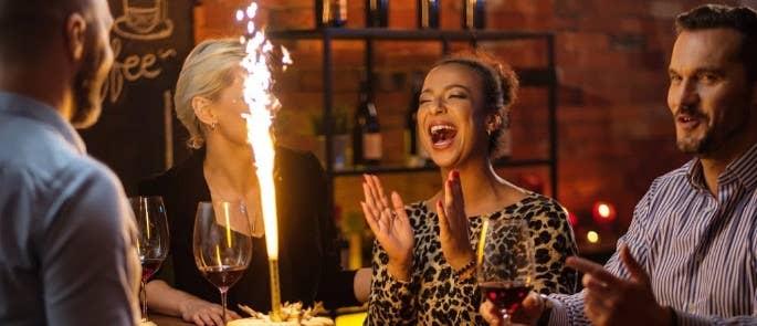 customer celebrating birthday in restaurant
