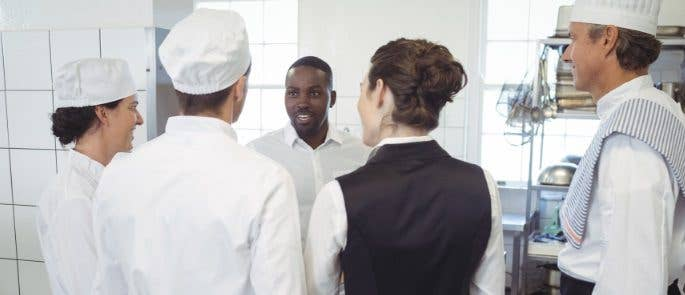 Team meeting in the restaurant kitchen for all staff