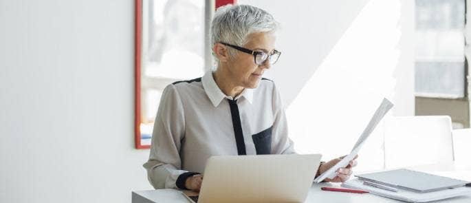 Teacher at a laptop making her professional development plan