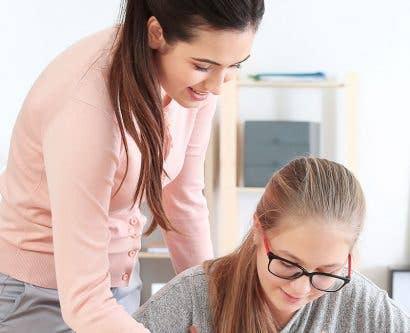 self-employed tutor helping child