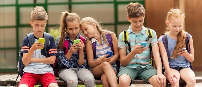 Group of children on their phones