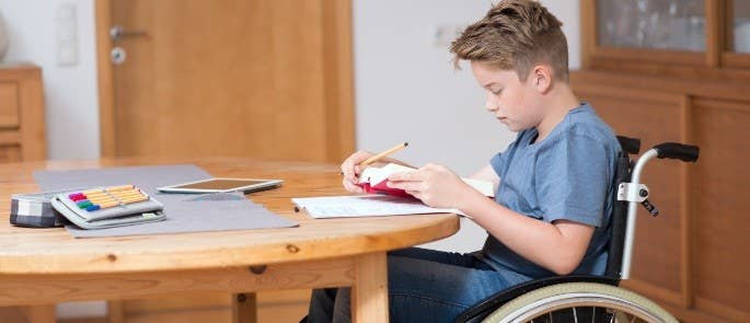 Student in a wheelchair completing their homework
