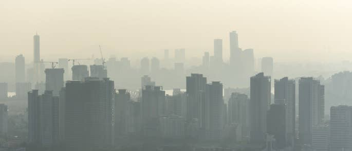 Landscape of urban city with visible air pollution