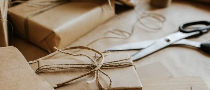 Wrapping presents up in brown paper and tieing with string