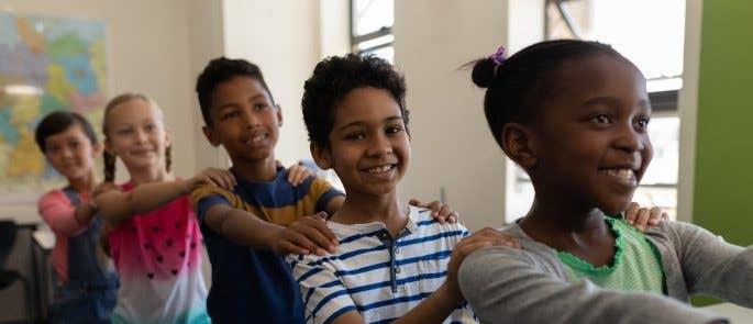 Children playing in school corridor
