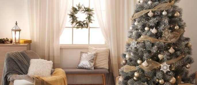 A christmas tree in a neutral living room