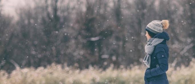 Woman walking outside in the snow