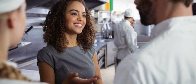 restaurant manager talks to staff