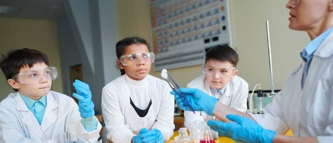 School children doing a chemistry experiment