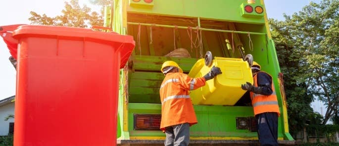 Recycling bins being emptied into a collection lorry