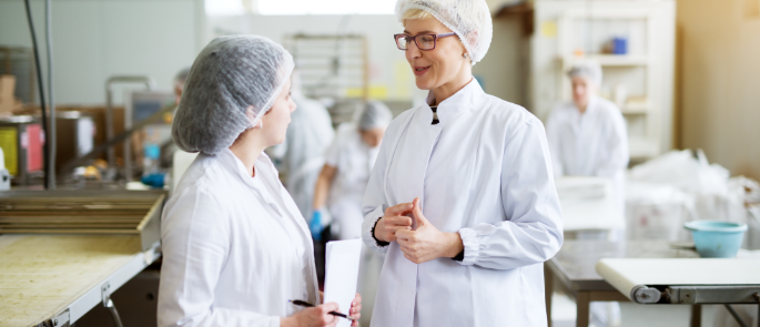 Ladies in hair nets and protective clothing